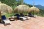 Relax under parasols by the pool