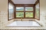 We love this large bath tub with forest views