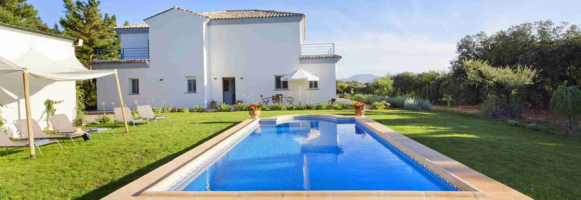 Gleaming Ronda villa with large private pool and green lawned gardens