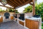 Outdoor barbecue / kitchen includes wood oven