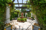 Pretty courtyard with pergola and climbers