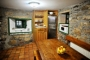 The kitchen retains a rustic character
