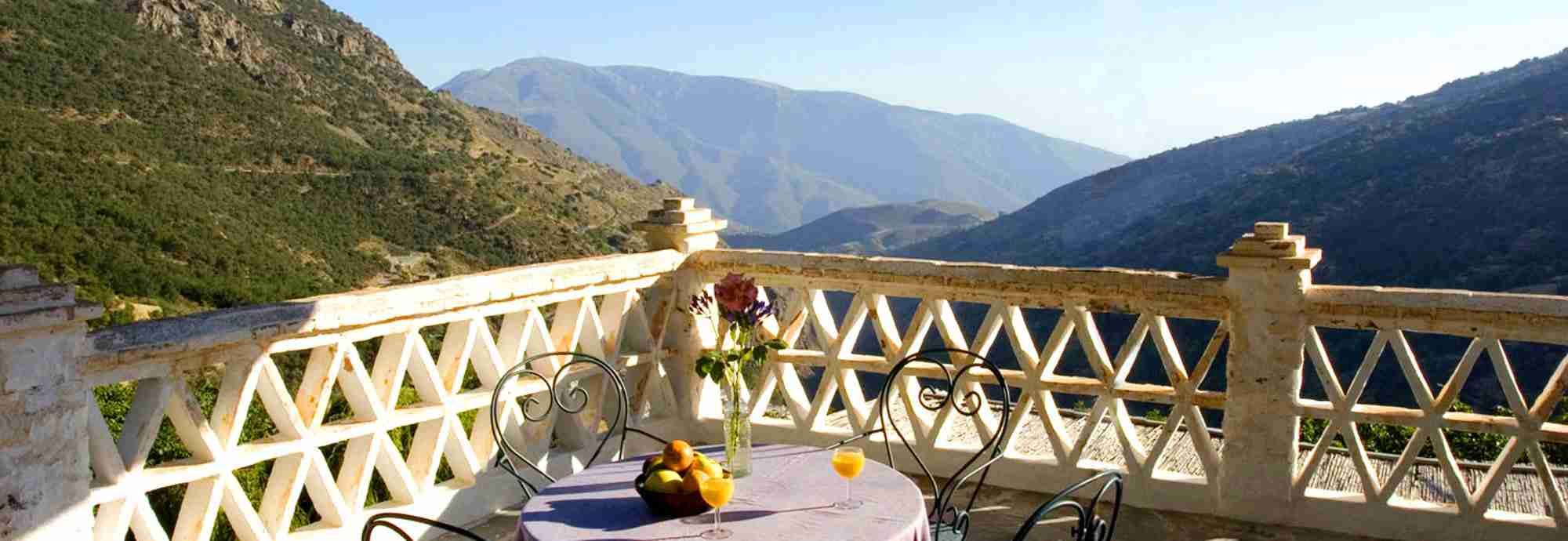 Traditional mountain village house with large terrace in Bubion